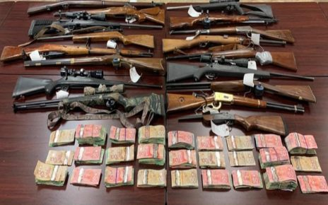 Firearms and money seized after police execute search warrant